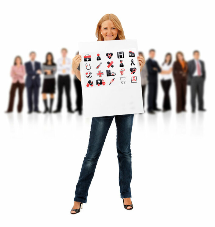Business woman standing holding a banner with her teamwork behind isolated on white
