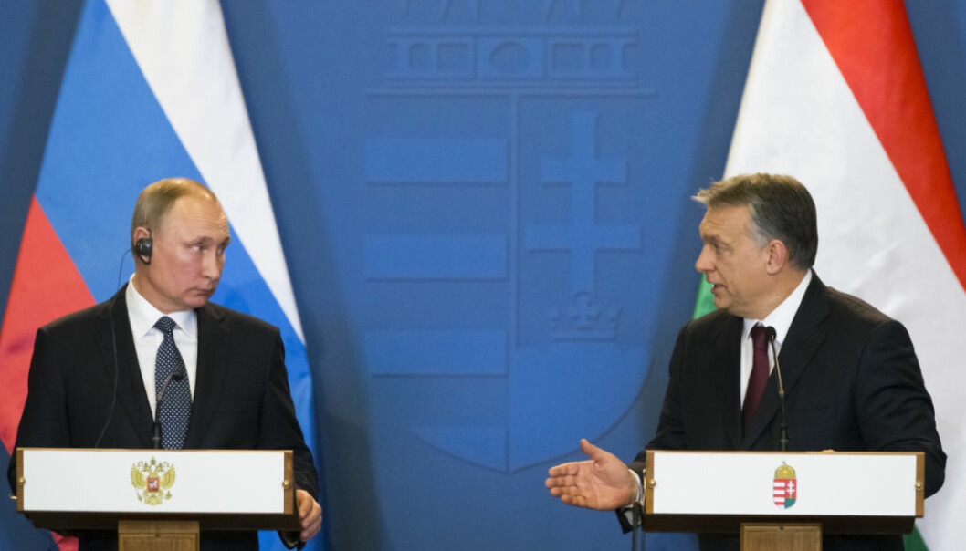 Russian President Vladimir Putin, left, and Hungarian Prime Minister Viktor Orban speak during their join news conference at the parliament building in Budapest, Hungary, Thursday, Feb. 2, 2017. Putin's visit to Hungary is his first trip to the European Union since the U.S. presidential election. The talks are expected to focus on energy cooperation. (AP Photo/Alexander Zemlianichenko)