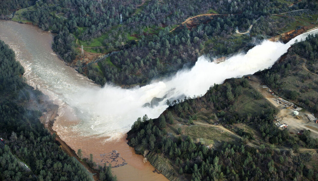 CORRECTS DATE TO MONDAY FEB 13, NOT 12 - Water continues to run down the main spillway at Lake Oroville on Monday, Feb. 13, 2017, in Oroville, Calif.  The water level dropped Monday behind the nation's tallest dam, reducing the risk of a catastrophic spillway collapse and easing fears that prompted the evacuation of nearly 200,000 people downstream.  Sunday afternoon's evacuation order came after engineers spotted a hole on the concrete lip of the secondary spillway for the 770-foot-tall Oroville Dam and told authorities that it could fail within the hour. (Randy Pench/The Sacramento Bee via AP)
