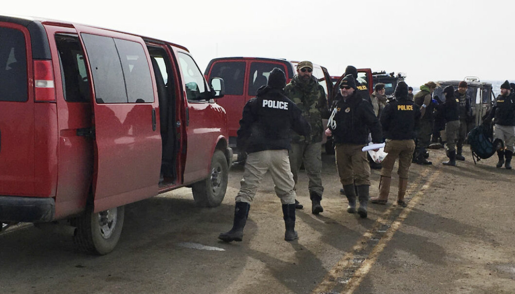 Authorities arrest the last remaining holdouts in the now-closed Dakota Access pipeline protest camp in southern North Dakota near Cannon Ball on Thursday, Feb. 23, 2017. Police made about several dozen arrests, and declared the camp cleared after about 3 1/2 hours. (Mike McCleary/Bismarck Tribune via AP)