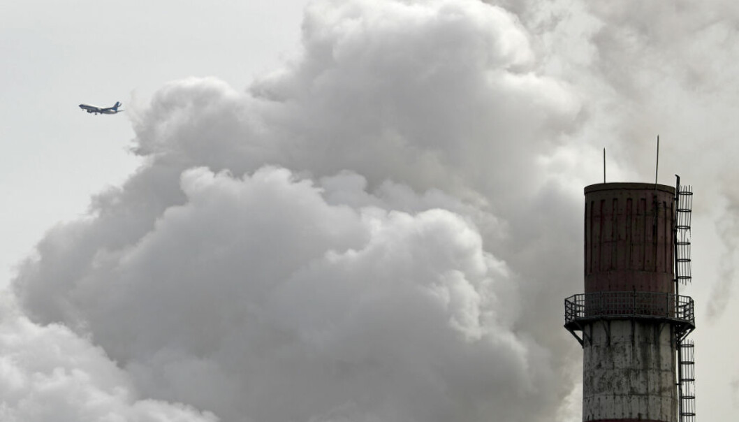 A passenger airliner flies past steam and white smoke emitted from a coal-fired power plant in Beijing, Tuesday, Feb. 28, 2017. China's consumption of coal fell in 2016 for a third year in a row, official data showed Tuesday, as the world's top polluter increasingly grapples with its massive pollution challenges. (AP Photo/Andy Wong)