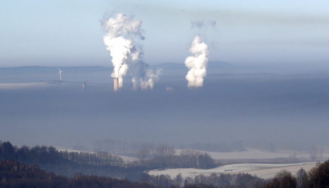 Smoke rises from chimneys of the coal-fired power plant in Bogatynia, Poland. The picture was taken from a hill near the town of Frydlant, Czech Republic, Tuesday, Feb. 14, 2017, as smog across coal-addicted Poland hit crisis levels recently. (AP Photo/Petr David Josek)