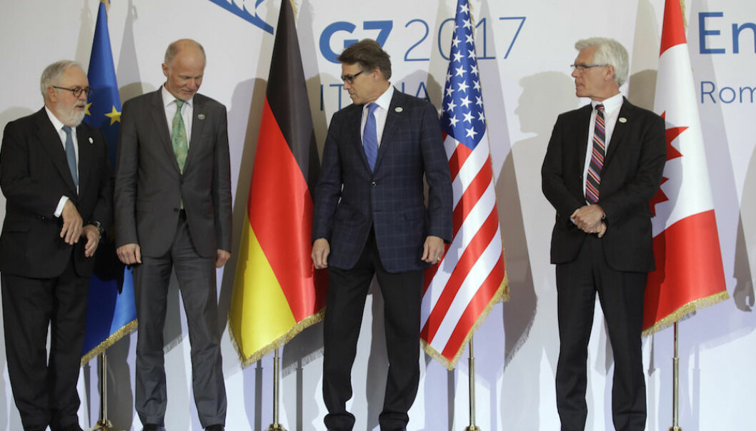 From left, European Commissioner for Cimate, Miguel Arias Canete, Energy ministers Germany's Rainer Baake, United States' Rick Perry, and Canada's James Gordon Carr pose for a photo during a G7 Energy meeting, in Rome, Monday, April 10, 2017. (AP Photo/Alessandra Tarantino)