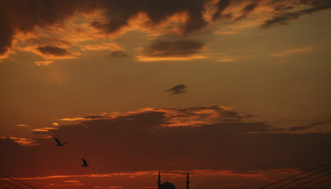 The sun sets behind the Suleymaniye Mosque in Istanbul, Saturday, April 15, 2017. Turkey is heading to a contentious referendum on Sunday April 16, on constitutional reforms to expand Turkey's President Recep Tayyip Erdogan's powers. (AP Photo/Emrah Gurel)
