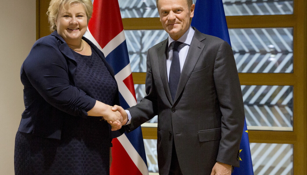 Norwegian Prime Minister Erna Solberg, left, is greeted by European Council President Donald Tusk prior to a meeting at the Europa building in Brussels on Thursday, May 4, 2017. (AP Photo/Virginia Mayo)