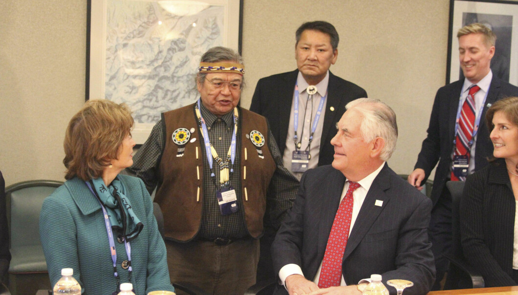 U.S. Secretary of State Rex Tillerson, seated right, and U.S. Sen. Lisa Murkowski, seated left, speak with representatives of Alaska Native groups at an Arctic Council event in Fairbanks, Alaska. High-level officials from the world's eight Arctic nations will meet in Alaska this week amid concerns about the future of the sensitive region after President Trump called for more oil drilling and development. (AP Photo/Mark Thiessen)