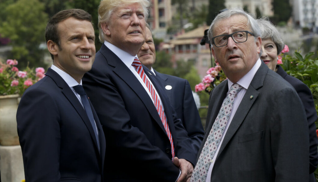 French President Emmanuel Macron, left, U.S. President Donald Trump and President of the EU Commission Jean-Claude Juncker watch the Frecce Tricolori Italian Air Force acrobatic squadron performing, in Taormina, Italy, Friday, May 26, 2017. Leaders of the G7 meet Friday and Saturday, including newcomers Emmanuel Macron of France and Theresa May of Britain in an effort to forge a new dynamic after a year of global political turmoil amid a rise in nationalism. (AP Photo/Luca Bruno)