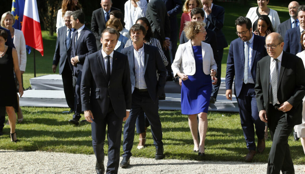 France's President Emmanuel Macron, center left, Environment Transition Minister Nicolas Hulot, background center, and French Foreign Minister Jean-Yves Le Drian, right, leave after the family photo prior to the first cabinet meeting at the Elysee Palace in Paris, Thursday, June 22, 2017. Macron brought several little-known figures into his government as part of a reshuffle after corruption scandals started tarnishing his young Cabinet. (AP Photo/Thibault Camus)