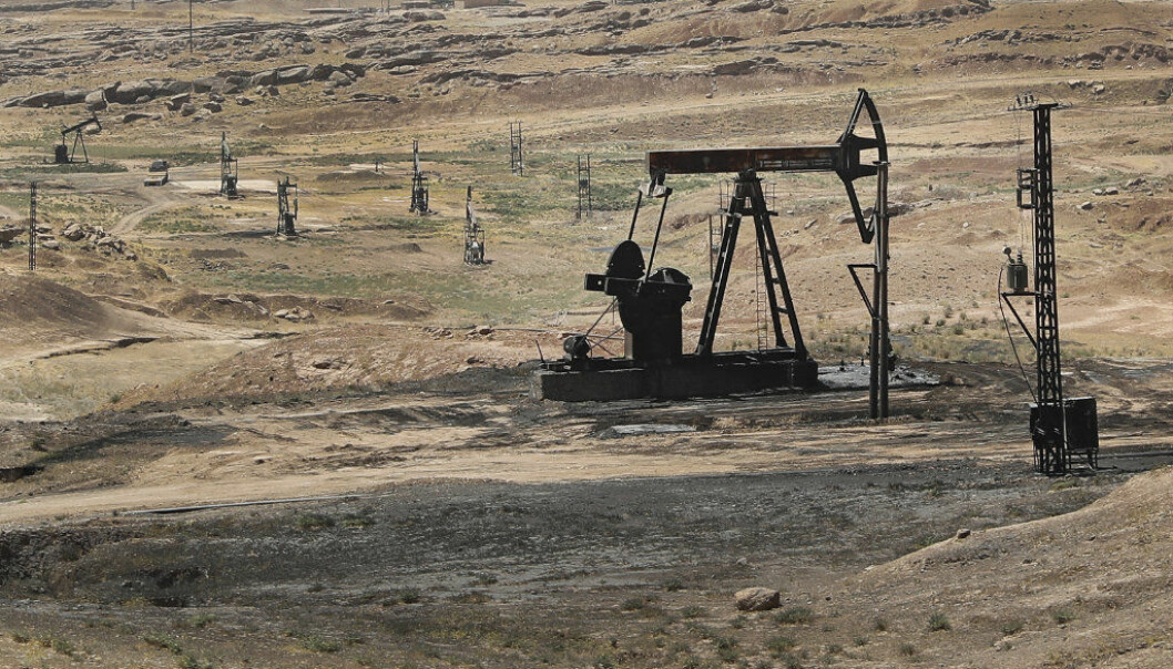 This July 30, 2017 photo, shows an oil field controlled by the Kurdish-led Syrian Democratic Forces (SDF), in Rmeilan, Hassakeh province, northeast Syria. The SDF, with air support from the U.S.-led coalition, said Sunday, Oct. 22, 2017 that they had captured the Al-Omar field, Syria's largest oil field, from the Islamic State group, marking a major advance against the extremists and for now keeping the area out of the hands of pro-government forces. (AP Photo/Hussein Malla)