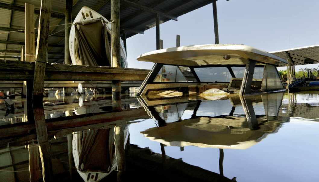 A boat is submerged in a Hurricane Harvey-damaged marina in Beaumont, Texas, Wednesday, Sept. 27, 2017. The marina's waters rose so high that several boats crashed through the high tin roofs above their slips. Jefferson County was drowned by more than 60 inches of rain during Hurricane Harvey, the most rainfall ever recorded in a single storm in the nation's history, according to preliminary data from the National Weather Service. (AP Photo/David Goldman)