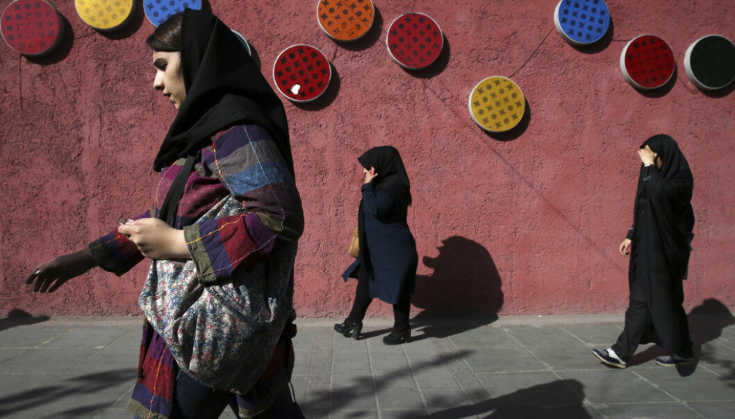 Pedestrians walk down a sidewalk in downtown Tehran, Iran, Saturday, Oct. 14, 2017. U.S. President Donald Trump's refusal to certify the Iran nuclear deal has sparked a new war of words between the Islamic republic and America, fueling growing mistrust and a sense of nationalism among Iranians. (AP Photo/Vahid Salemi)