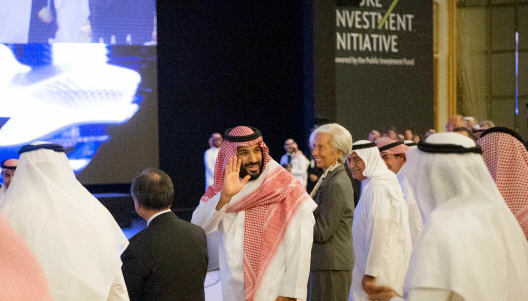 """In this photo released by Saudi Press Agency, SPA, Saudi Crown Prince Mohammed bin Salman, center left, and Managing Director of International Monetary Fund Christine Lagarde, center right, attend the opening ceremony of Future Investment Initiative Conference in Riyadh, Saudi Arabia, Tuesday, Oct. 24, 2017. Saudi Arabia's powerful crown prince on Tuesday announced plans to build a futuristic city run entirely on alternative sources of energy and said the ultraconservative kingdom must return to """"moderate Islam."""" (Saudi Press Agency via AP)"""