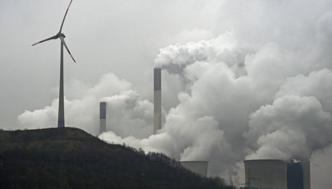 FILE - In this file photo dated Monday, Dec. 1, 2014, a wind turbine overlooks the coal-fired power station in Gelsenkirchen, Germany. The UN Climate Change Conference 2017 will take place under Presidency of the Government of Fiji in Bonn,  Germany and starts on Monday, Nov. 6, 2017.  (AP Photo/Martin Meissner, file)