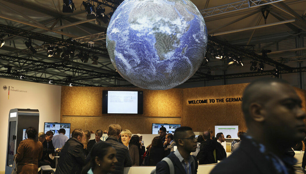 Delegates and visitors walk inside the German pavilion at the World Climate Conference in Bonn, Germany, Monday, Nov. 6, 2017. (Oliver Berg/dpa via AP)
