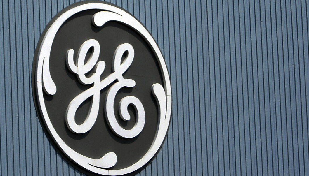 FILE - This June 24, 2014, file photo, shows the General Electric logo at a plant in Belfort, France. On Thursday, Dec. 7, 2017, GE said it will cut 12,000 jobs in its power division as alternative energy supplants demand for coal and other fossil fuels. (AP Photo/Thibault Camus, File)