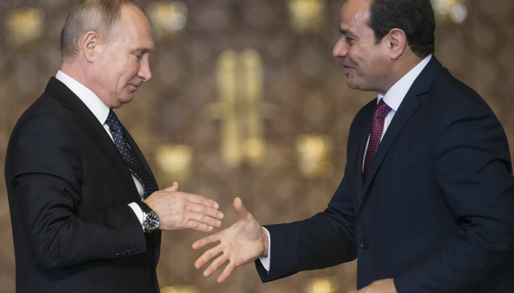 Russian President Vladimir Putin, left, Egyptian President Abdel-Fattah El-Sissi, shake hands after a news conference following their talks in Cairo, Egypt, Monday, Dec. 11, 2017. (Alexander Zemlianichenko/pool photo via AP)