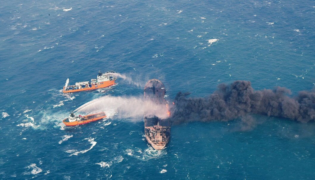 In this Wednesday, Jan. 10, 2018, photo provided by China's Ministry of Transport, firefighting boats work to put on a blaze on the oil tanker Sanchi in the East China Sea off the eastern coast of China. Rescue ships looking for missing crew members from the oil tanker Sanchi have expanded their search area to more than 2,600 square kilometers (1,000 square miles) as Chinese state television reported Friday that maritime authorities still have not found any survivors, or put out the blaze onboard the ship. (Ministry of Transport via AP)
