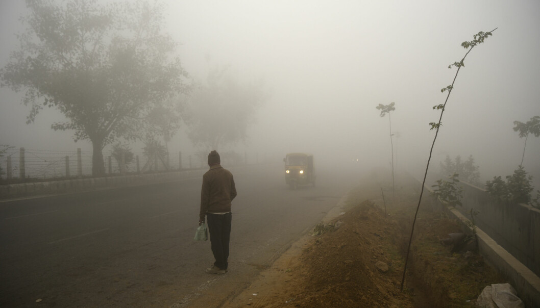A man awaits transport surrounded by a thick fog in the morning in Greater Noida, outskirts of New Delhi, India, Sunday, Dec. 31, 2017. As winter approaches, a thick, soupy smog routinely envelops most parts of northern India, caused by dust, the burning of crops, emissions from factories and the burning of coal and piles of garbage as the poor try to keep warm. Over the past two years, New Delhi has earned the dubious distinction of being one of the world's most polluted cities. (AP Photo/R S Iyer)