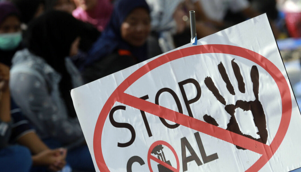Protesters gather near the government house to protest the construction of a coal power plant in Bangkok, Thailand, Tuesday, Feb. 20, 2018. Protesters seeking to stop construction of coal-fired power plants in the country's south have claimed victory, as the Energy Ministry agreed to order news assessments of the health and environment impacts of the projects. (AP Photo/Sakchai Lalit)