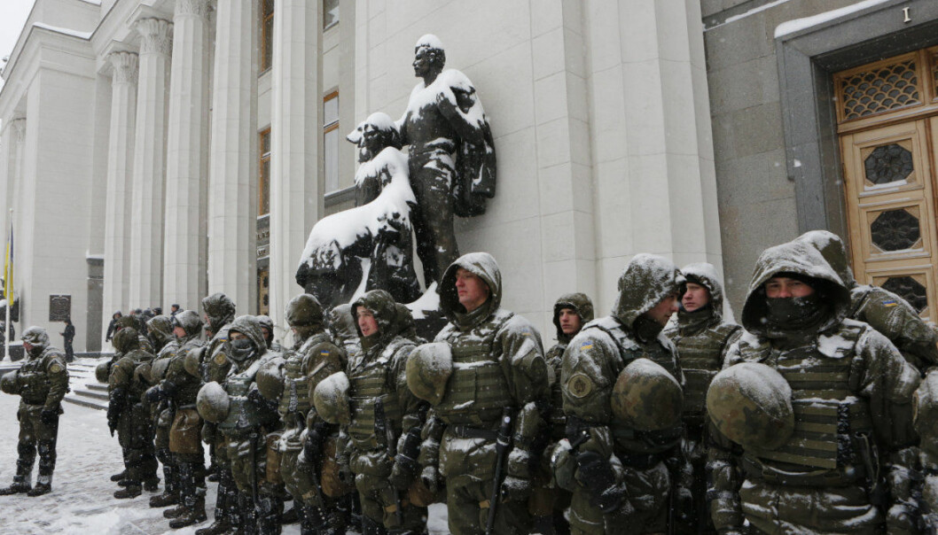 National Guard officers stand guard in front of the parliament building as members of the Movement of New Forces, the political party led by Mikheil Saakashvili, protest in front of the parliament building in Kiev, Ukraine, Thursday, March 1, 2018, demanding the resignation of President Poroshenko. (AP Photo/Efrem Lukatsky)