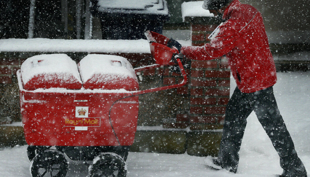 A postman makes his way through heavy snowfall in London, Wednesday, Feb. 28, 2018. Britain, which is buffered by the Atlantic Ocean and tends to have temperate winters, saw heavy snow that disrupted road, rail and air travel and forced hundreds of schools to close. (AP Photo/Frank Augstein)