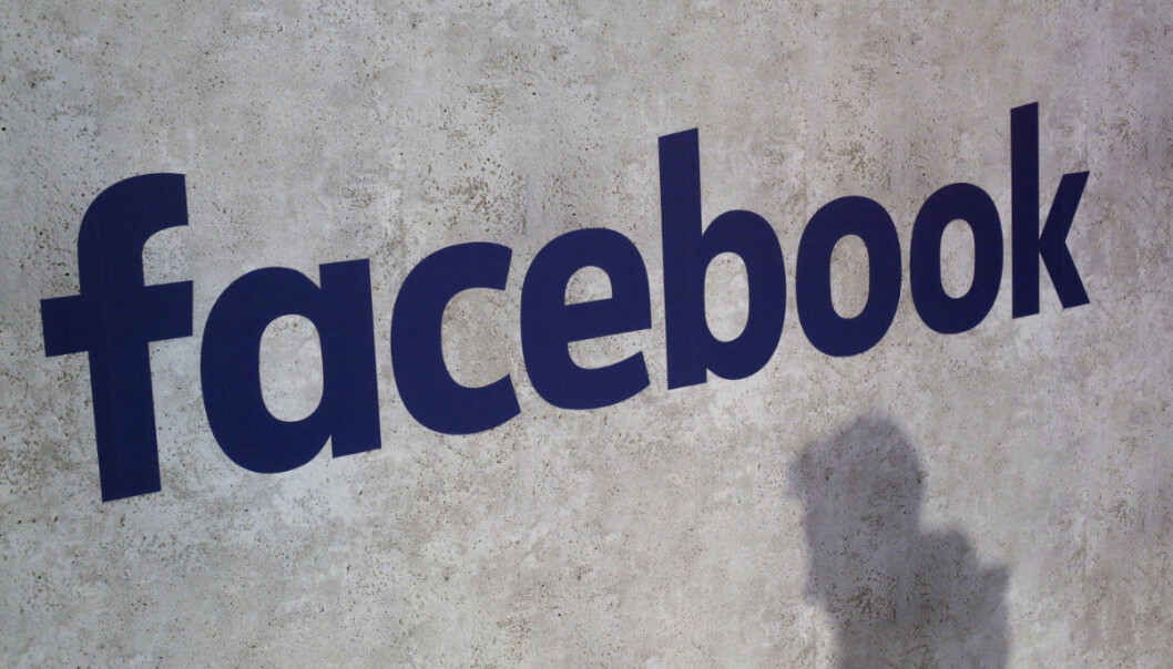 """File - This Jan. 17, 2017, file photo shows a Facebook logo being displayed in a start-up companies gathering at Paris' Station F, in Paris. A former employee of a Trump-affiliated data-mining firm says it used algorithms that """"took fake news to the next level"""" using data inappropriately obtained from Facebook. (AP Photo/Thibault Camus, File)"""