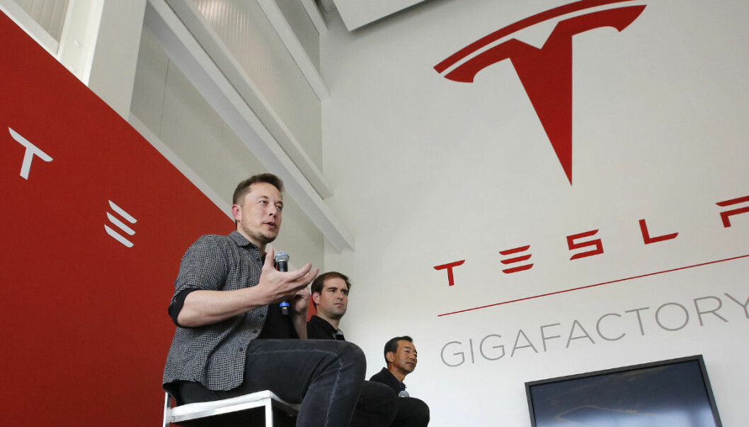 FILE - In this July 26, 2016, file photo, Elon Musk, CEO of Tesla Motors Inc., left, discusses the company's new Gigafactory in Sparks, Nev. Shareholders of electric car and solar panel maker Tesla Inc. are voting on a pay package for Musk that could net him more than $50 billion if he meets lofty milestones over the next decade that include raising the company's market value tenfold. (AP Photo/Rich Pedroncelli, File)