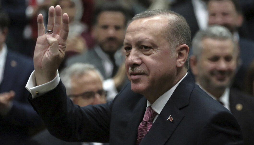 FILE - In this Feb. 20, 2018 file photo, Turkey's President Recep Tayyip Erdogan waves as he arrives to parliament in Ankara, Turkey. Egyptians go to the polls next week in what is essentially a one-candidate election -- but almost nowhere has democracy taken hold in the region. Turkey has free elections but an increasingly illiberal system whose politicized security apparatus and judiciary has put many thousands of opponents of Erdogan in jail. (AP Photo/Burhan Ozbilici, File)