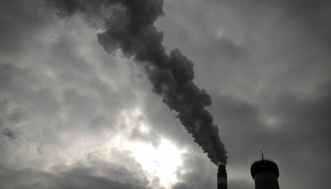 FILE - In this Nov. 3, 2015 photo, smoke and steam rise from the smokestack of a coal-fired power plant near Ordos in northern China's Inner Mongolia Autonomous Region. The global fleet of coal-fired power plants is projected to begin shrinking by 2022 as plant retirements outpace new construction, according to a new report that warns the heavily-polluting fuel's decline may not come quickly enough to meet international emission reduction goals intended to stave off climate change. (AP Photo/Mark Schiefelbein, File)