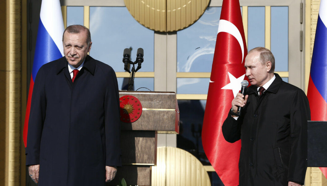 Turkey's President Recep Tayyip Erdogan left, listens to Russia's President Vladimir Putin, right, talking during a welcome ceremony, in Ankara, Turkey, Tuesday, April 3, 2018. Turkey and Russia have put aside their traditional rivalries and differences on regional issues, to forge closer ties. (AP Photo/Burhan Ozbilici)