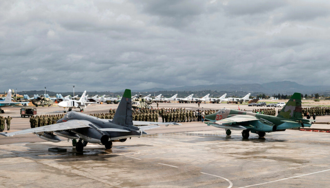 FILE - This file photo provided March 15, 2016, by the Russian Defense Ministry Press Service, a lineup of Russian troops is held before withdrawal at Hemeimeem air base in Syria. With the Middle East on edge and many fearing inadvertent triggering of regional war, it is easy to forget that two weeks ago Trump shocked advisers in declaring an intention to withdraw troops from Syria. Now, apparently angered by a suspected chemical attack, Trump is threatening imminent military strikes against the Syrian government forces he blames and rattling a saber at Syria's patron Russia. (Vadim Grishankin/Russian Defense Ministry Press Service via AP, File)