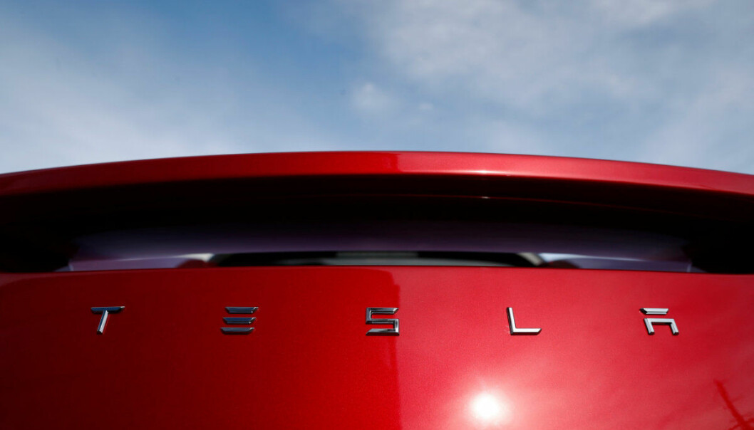 FILE- In this Sunday, April 15, 2018, file photo, the sun shines off the rear deck of a roadster on a Tesla dealer's lot in the south Denver suburb of Littleton, Colo. Tesla, Inc. reports earnings Wednesday, May 2. (AP Photo/David Zalubowski, File)