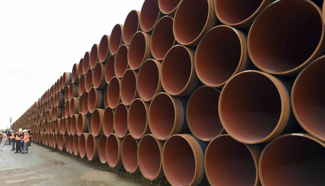 "FILE - In this May 8, 2017 photo steel pipes for the North Stream 2 pipeline are stacked in Mukran harbour in Sassnitz, Germany. American officials say a pipeline project between Russia and Germany risks triggering U.S. sanctions because of security concerns. Senior State Department diplomat Sandra Oudkirk says the United States opposes the Nord Stream 2 gas pipeline because it could increase Russia's ""malign influence"" in Europe. (Stefan Sauer/dpa via AP, file)"