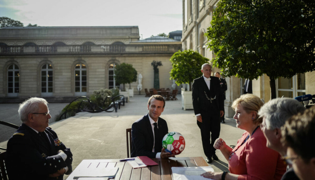 French President Emmanuel Macron, centre, holds a soccer ball offered by Norway's Prime Minister Erna Solberg during a bi-lateral meeting at the Elysee Palace, in Paris, Friday, July 6, 2018. (AP Photo/Kamil Zihnioglu, Pool)