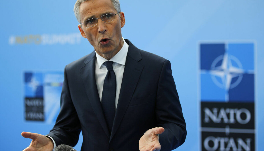NATO Secretary General Jens Stoltenberg gestures as he speaks upon his arrival for a summit of heads of state and government at NATO headquarters in Brussels on Wednesday, July 11, 2018. NATO leaders gather in Brussels for a two-day summit to discuss Russia, Iraq and their mission in Afghanistan. (AP Photo/Francois Mori)
