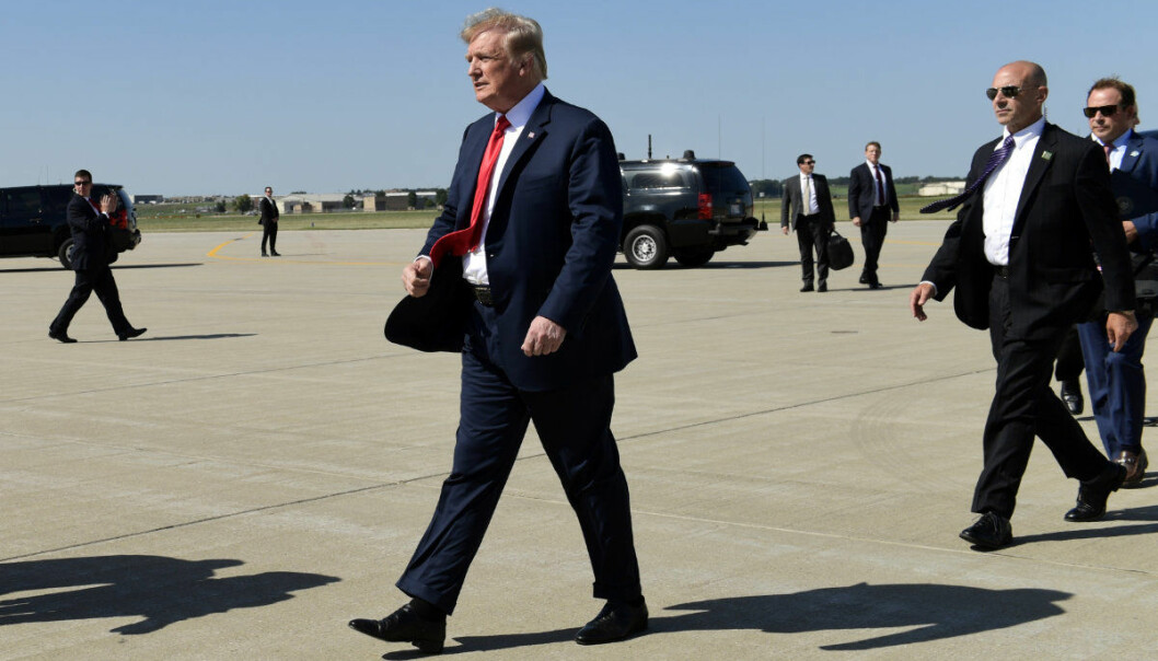 President Donald Trump walks over to greet people after arriving at Sioux Falls Regional Airport, in Sioux Falls, S.D., Friday, Sept. 7, 2018. Trump is in Sioux Falls to speak at the Noem-Rhoden Victory Committee, a joint fundraising committee authorized by and composed of Kristi Noem for Governor, Larry Rhoden for Lieutenant Governor, KRISTI PAC and the South Dakota Republican Party. (AP Photo/Susan Walsh)