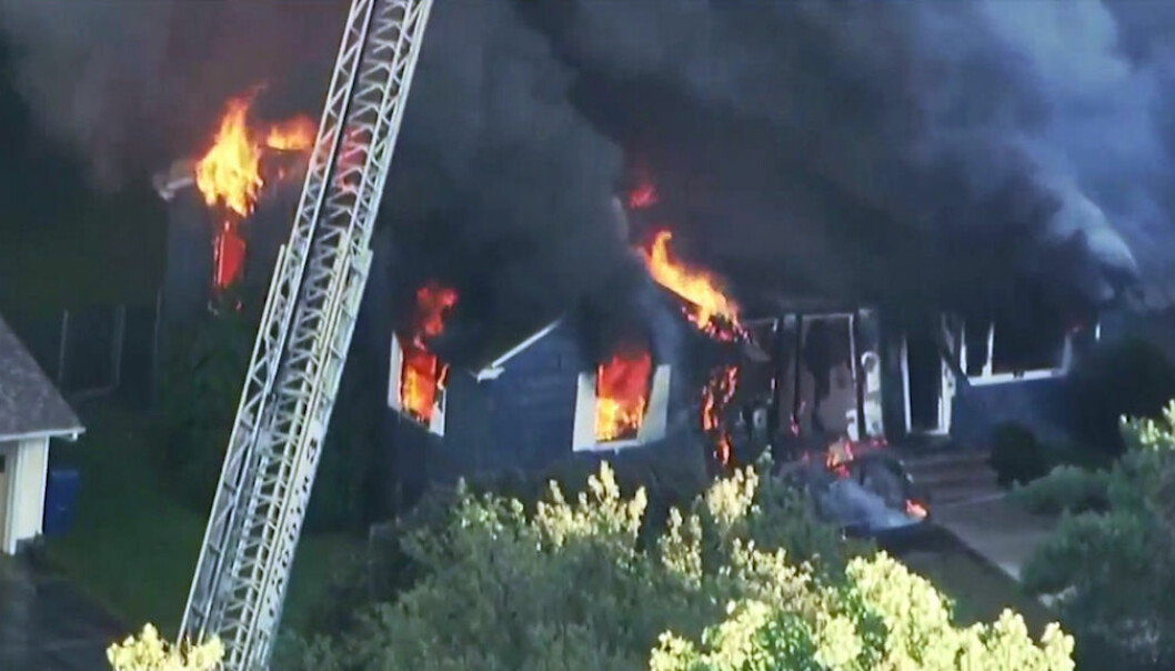 In this image take from video provided by WCVB in Boston, flames burn through a home in Lawrence, Mass, a suburb of Boston, Thursday, Sept. 13, 2018. Emergency crews are responding to what they believe is a series of gas explosions that have damaged homes across three communities north of Boston. (WCVB via AP)