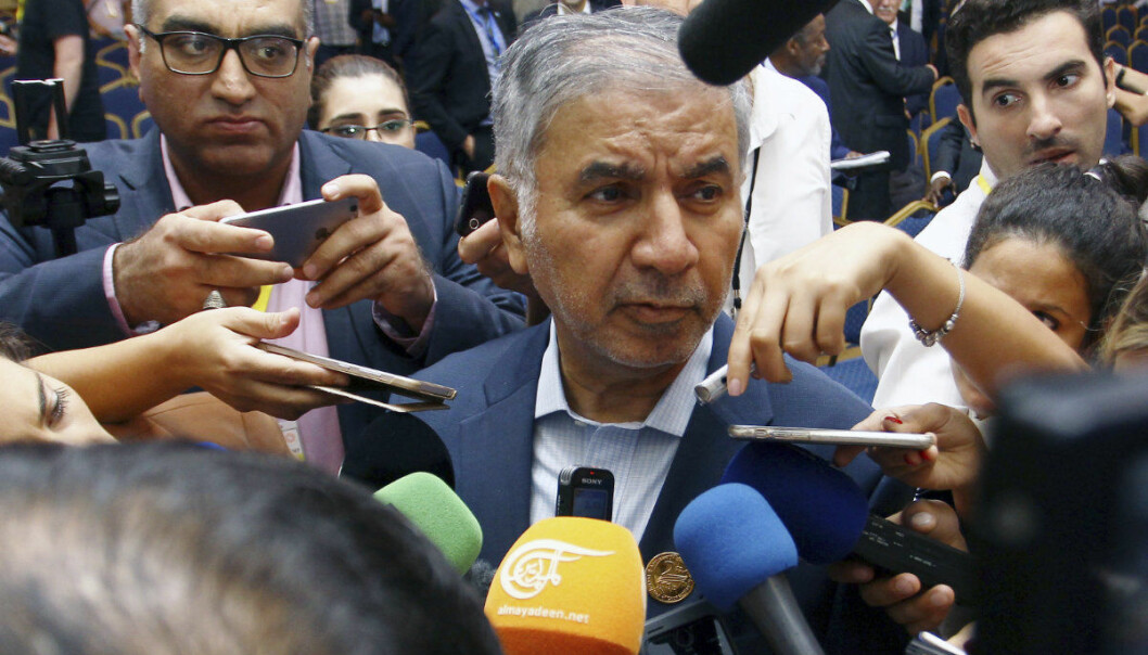 Iran's Organization of the Petroleum Exporting Countries (OPEC) governor Hossein Kazempour Ardebili, center, speaks to journalists during OPEC's 10th meeting of the Joint Ministerial Committee to monitor the oil production reduction agreement of the Organization of the Petroleum Exporting Countries, OPEC, and non-OPEC members, in Algiers, Algeria, Sunday, Sept. 23, 2018. The meeting of OPEC and its allies ended Sunday without any decision to further increase oil output, despite President Donald Trump's call for lower prices. (AP Photo/Anis Belghoul)