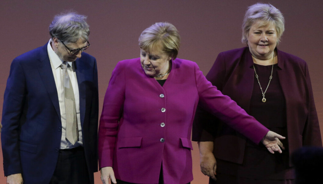 Norwegian Prime Minister Erna Solberg, German Chancellor Angela Merkel and former Microsoft CEO and co-founder Bill Gates, from right, pose for a group photo at the World Health Summit & Grand Challenges Annual Meeting in Berlin, Tuesday, Oct. 16, 2018. (AP Photo/Markus Schreiber)