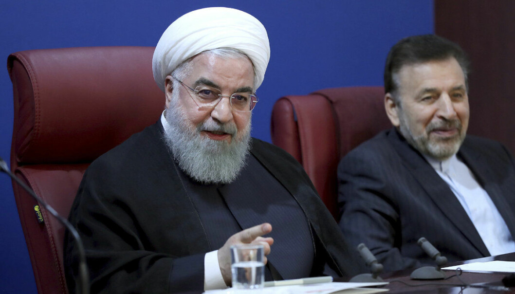 "In this photo released by official website of the office of the Iranian Presidency, President Hassan Rouhani speaks in a meeting with finance ministry officials in Tehran, Iran, Monday, Nov. 5, 2018. Iran greeted the re-imposition of U.S. sanctions on Monday with air defense drills and an acknowledgement from President Hassan Rouhani the nation faces a ""war situation,"" raising Mideast tensions as America's maximalist approach to the Islamic Republic takes hold. (Iranian Presidency Office via AP)"