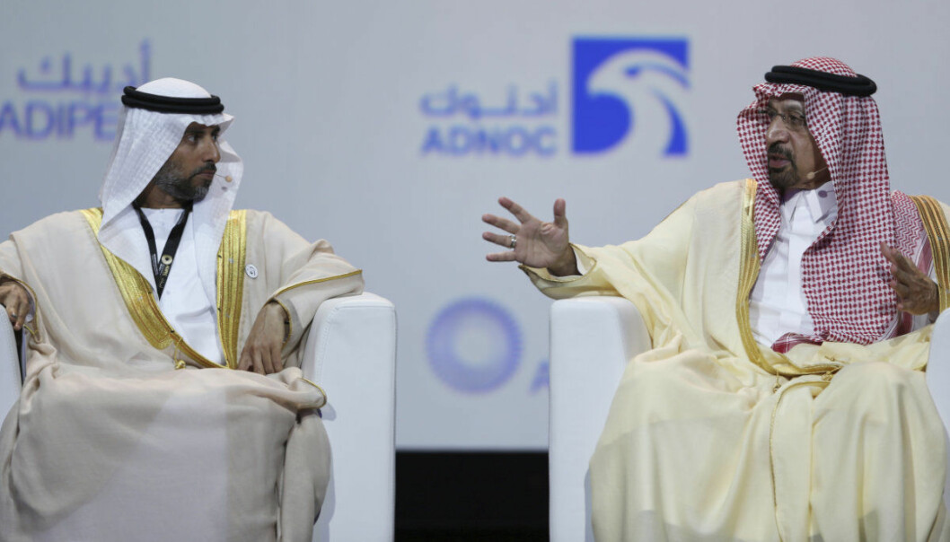 UAE Energy Minister Suhail al-Mazrouei, left, listens to Khalid Al-Falih, Saudi Energy and Oil Minister, in the opening ceremony of the Abu Dhabi International Exhibition & Conference, ADIPEC, in Abu Dhabi, United Arab Emirates, Monday, Nov.12, 2018. OPEC and allied oil-producing countries likely need to cut crude supplies to rebalance the market after proposed U.S. sanctions on Iran failed to cut Tehran's ouput, top Saudi and Emirati energy officials said Monday. (AP Photo/Kamran Jebreili)
