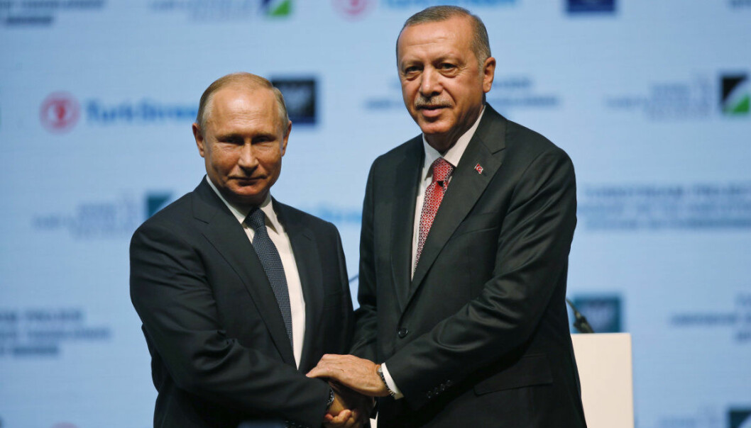Russian President Vladimir Putin, left, and Turkey's President Recep Tayyip Erdogan, shake hands after attending an event marking the completion of one of the phases of the Turkish Stream natural gas pipeline, in Istanbul, Monday, Nov. 19, 2018. (AP Photo/Lefteris Pitarakis)