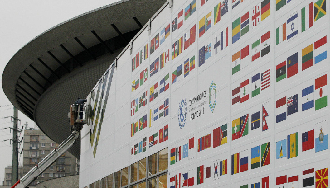 In this Nov. 20, 2018 photo workers decorate the venue of the global climate summit that will be held at the site of the closed 'Katowice' coal mine in the city of Katowice, southern Poland, where - three years after sealing a landmark global climate deal in Paris - world leaders are gathering again to agree on the fine print. (AP Photo/Czarek Sokolowski)