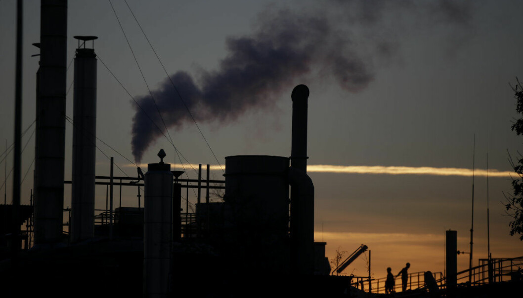Smoke billows from a chimney of the Solvay factory for production and process of plastic materials, in Ospiate, near Milan, Italy, Tuesday, Dec. 4, 2018. The climate change conference, COP24, is under way in Katowice, Poland, from Dec. 2-14, 2018. (AP Photo/Luca Bruno)