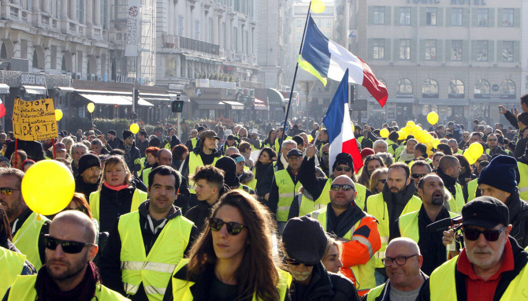 Demonstrators wearing their yellow vests demonstrate during in Marseille, southern France, Saturday, Dec. 29, 2018. The yellow vest movement held several peaceful demonstrations in cities and towns around France, including about 1,500 people who marched through Marseille. (AP Photo/Claude Paris)