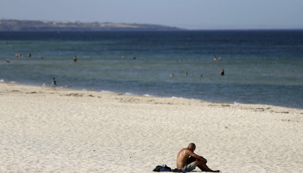 A beachgoer sits in the sun on Glenelg Beach in Adelaide, Australia, Thursday, January 24, 2019. Adelaide sweltered through the highest temperature ever recorded by a major Australian city on Thursday, peaking at a searing 46.6 degrees Celsius (115.9 degrees Fahrenheit) as the drought-parched nation heads toward potentially the hottest January on record. (Kelly Barnes/AAP Image via AP)