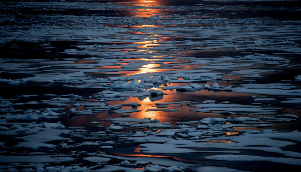 FILE- In this July 23, 2017, file photo the midnight sun shines across sea ice along the Northwest Passage in the Canadian Arctic Archipelago. The magnetic north pole is wandering about 34 miles (55 kilometers) a year. At the end of 2017 it crossed the international date line. That means it's not even the same day at the new magnetic north pole as it is at the spot of 2010's magnetic north pole. It's leaving the Canadian Arctic on its way to Siberia. (AP Photo/David Goldman, File)