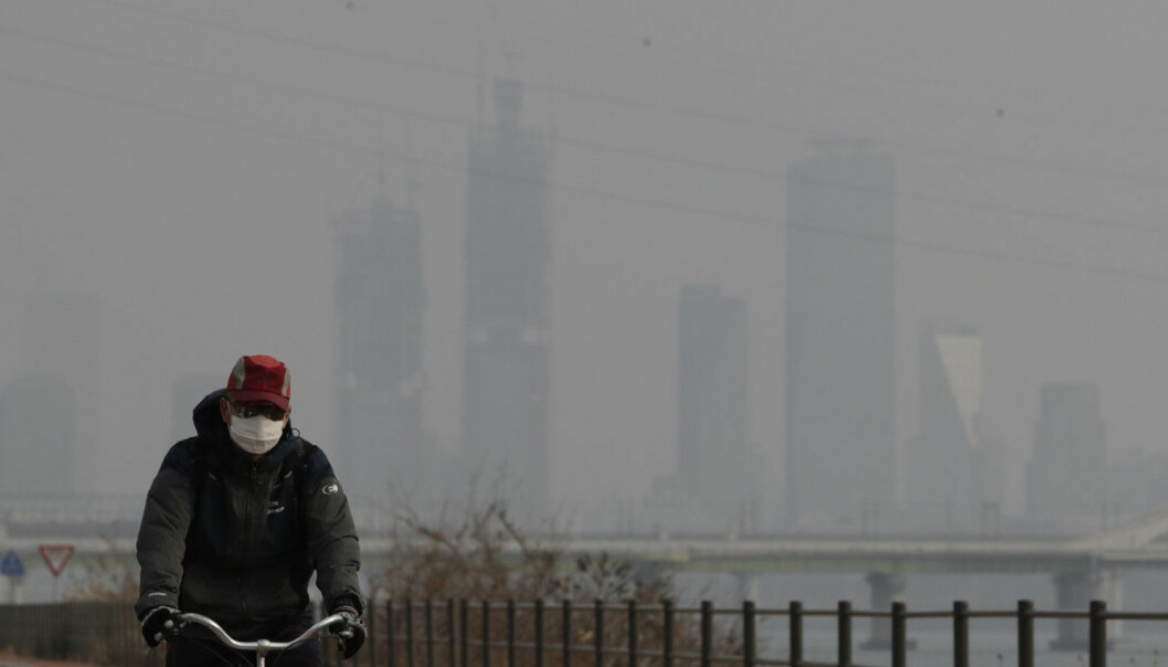 A man wearing a mask rides a bicycle along the Han river in Seoul, South Korea, Wednesday, March 6, 2019. South Korean President Moon Jae-in has proposed a joint project with China to use artificial rain to clean the air in Seoul, where an acute increase in pollution has caused alarm. (AP Photo/Lee Jin-man)