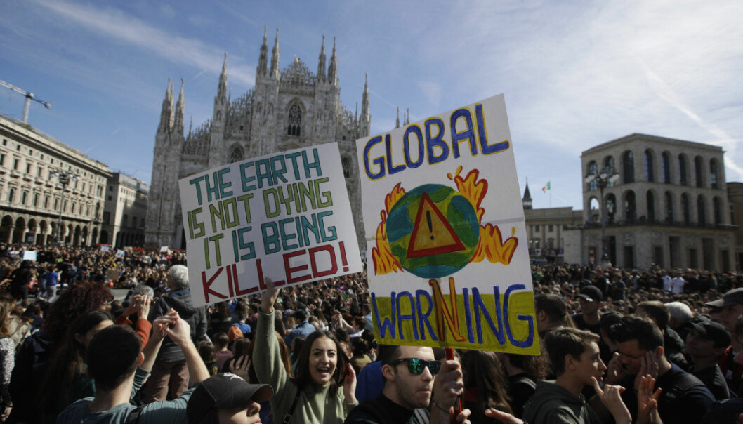 Students stage a protest in front of the Duomo gothic cathedral, in Milan, Italy, Friday, March 15, 2019. Students worldwide are skipping class Friday to take to the streets to protest their governments' failure to take sufficient action against global warming. (AP Photo/Luca Bruno)